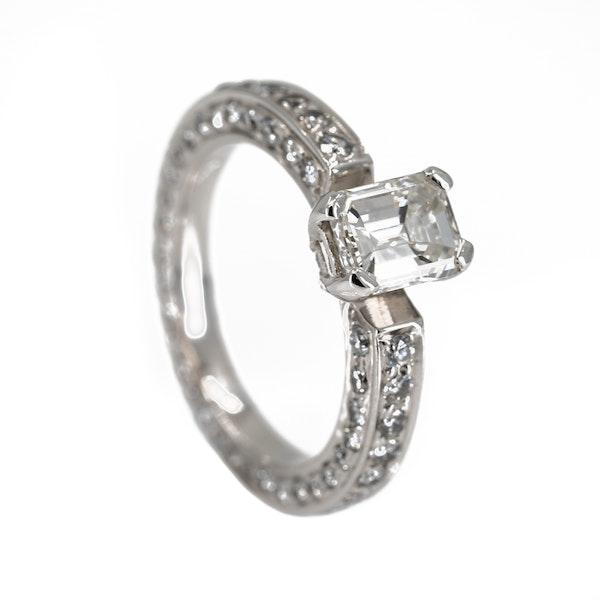 Diamond solitaire emerald cut of 0.95 ct est. set on full diamond eternity ring - image 2
