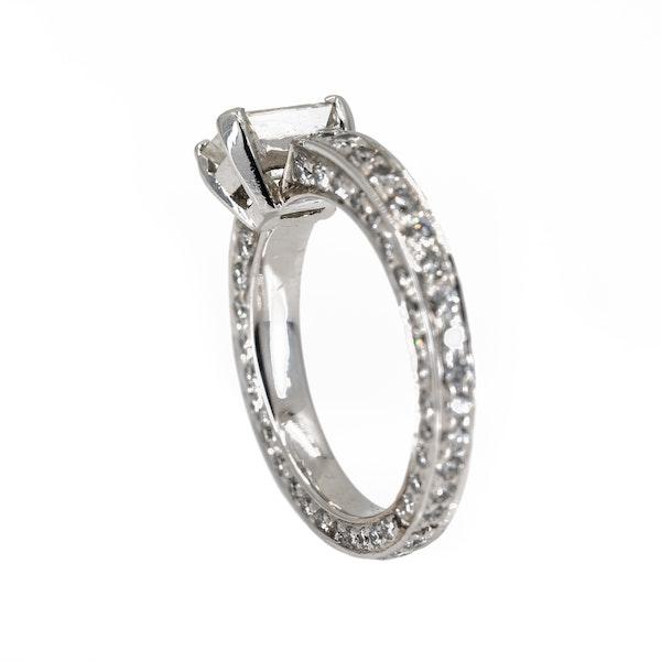 Diamond solitaire emerald cut of 0.95 ct est. set on full diamond eternity ring - image 3