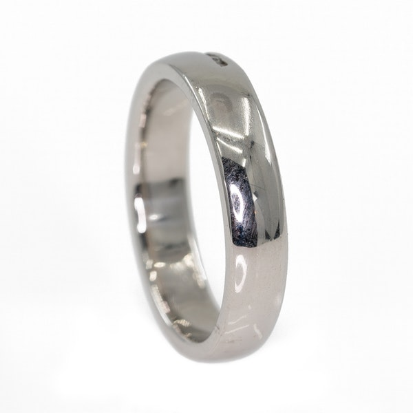 Heavy platinum ring set with a row of small diamonds - image 3