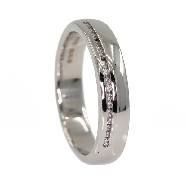 Heavy platinum ring set with a row of small diamonds - image 2