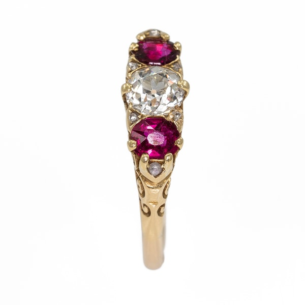 Ruby and diamond three stone half hoop carved ring with diamond points - image 1