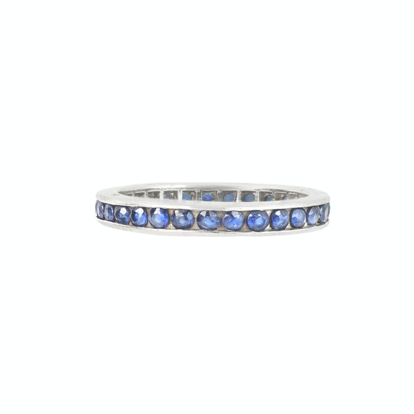 A Gold Sapphire Eternity Ring - image 1