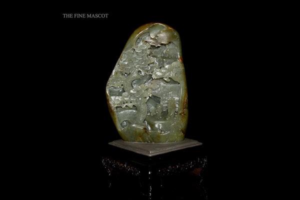 River jade boulder on wooden stand - image 1