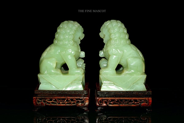 Guardian Lions jade sculptures on stand - image 2