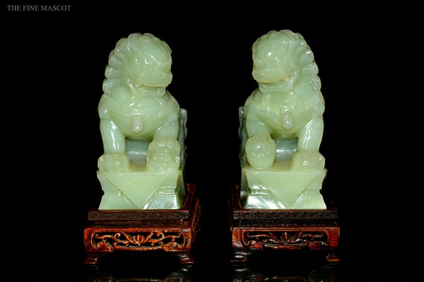Guardian Lions jade sculptures on stand - image 5