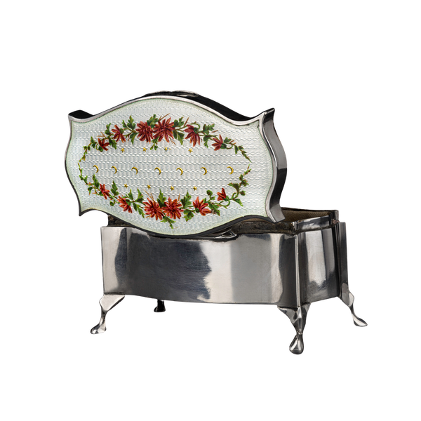 A silver and enamel jewellery box on feet - image 1