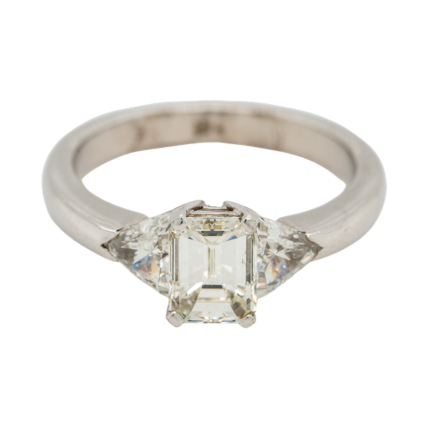 Emerald cut diamond ring with triangular cut diamond shoulders - image 1