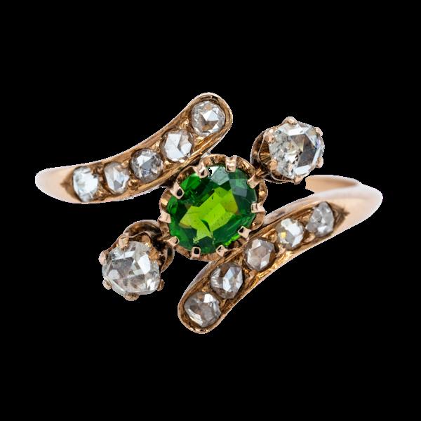 Demantoid green garnet and  diamond crossover ring. - image 1