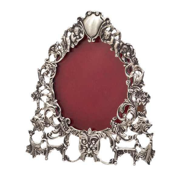 A small antique silver oval cast frame - image 1
