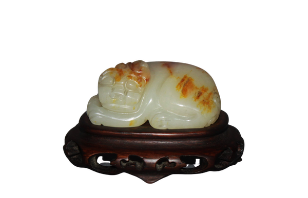A Chinese jade carving of a lion dog. - image 1