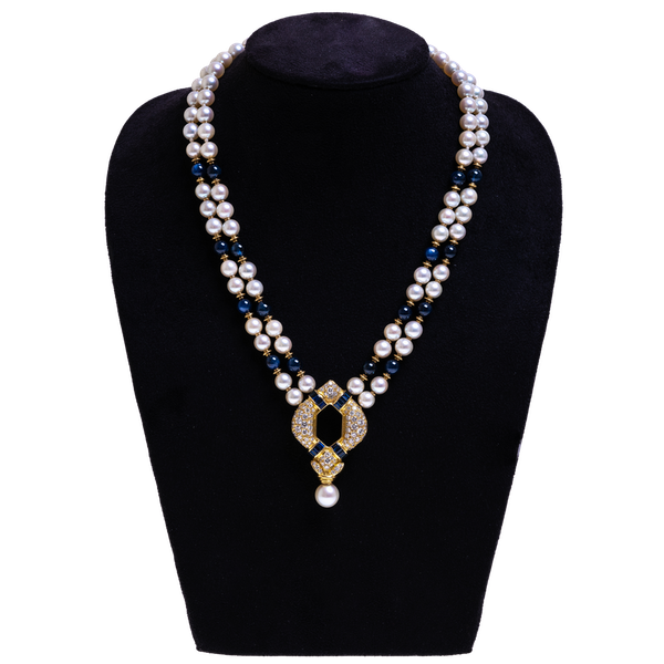 A diamond, sapphire and gold necklace - image 1