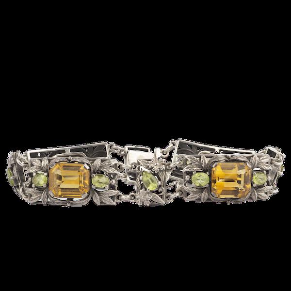 A Silver, Citrine and Peridot bracelet by Bernard Instone - image 1