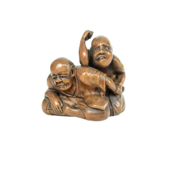 Japanese wood carving of two men - image 1
