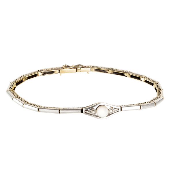 An Eighteen Carat Gold, Platinum, and Natural Pearl Bracelet - image 1