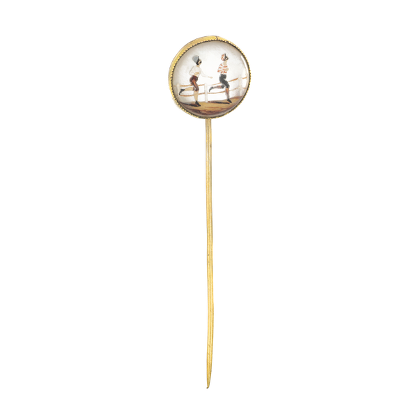 A Gold Rock Crystal Tie Pin of runners in a race - image 1