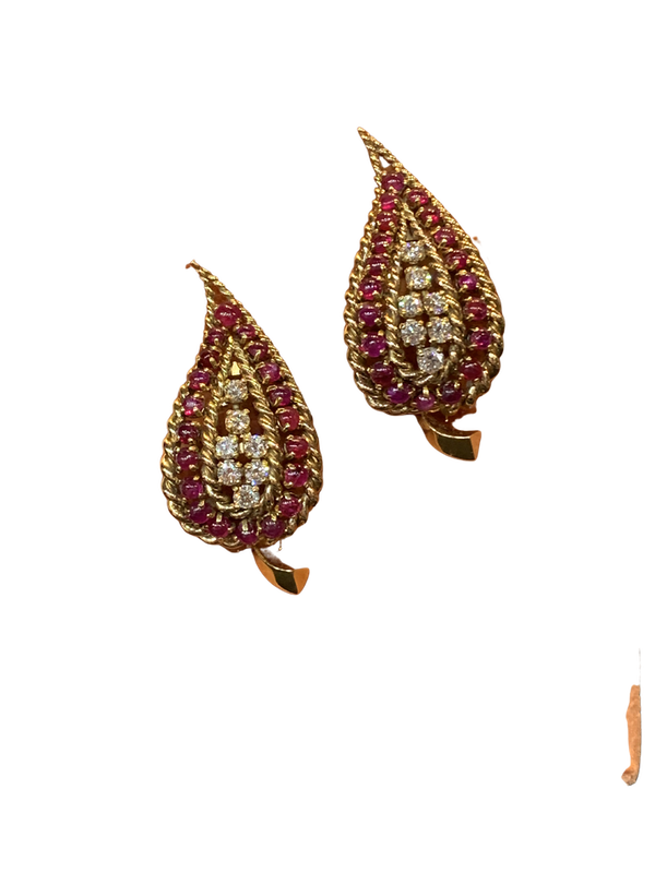 A pair of elliptical shaped ruby and diamond dress clips - image 1