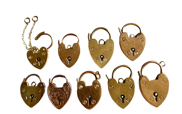 Gold padlocks available to be worn as pendants or added to charm bracelets. Spectrum - image 1