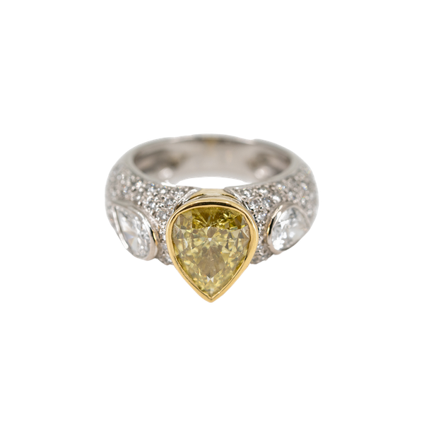 """A Dress Ring Set With A """"Fancy"""" Yellow Pear Shaped Diamond Offered By The Gilded Lily - image 1"""