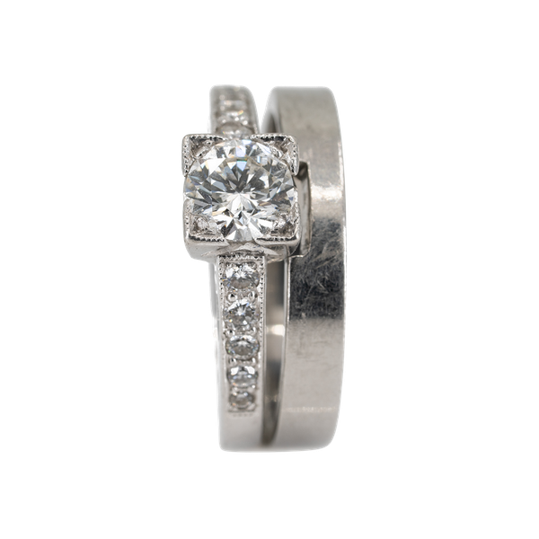 Diamond solitaire ring with diamond shoulders together with plain platinum wedding ring with a cut out for the diamond ring - image 1