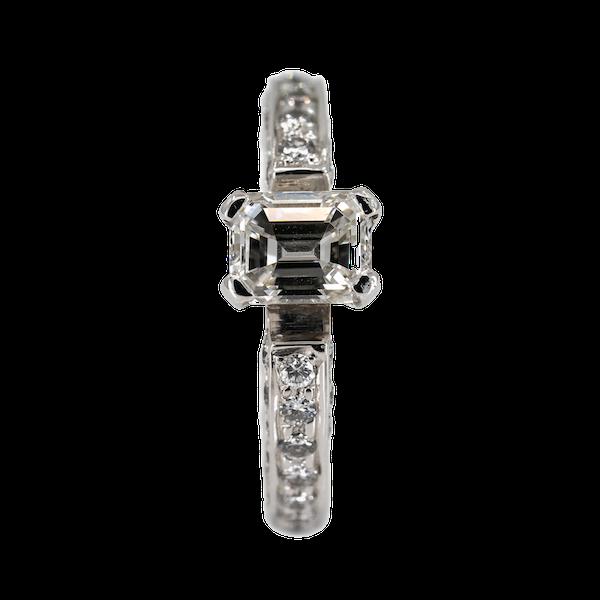 Diamond solitaire emerald cut of 0.95 ct est. set on full diamond eternity ring - image 1