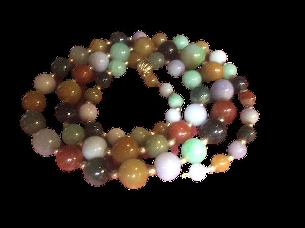 A long row of mixed colour jade beads - image 1